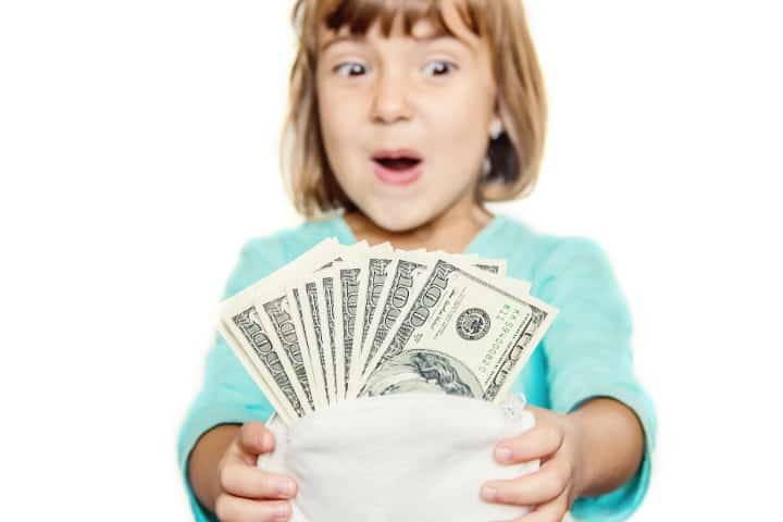 Girl is super excited holding an envelop full of money. Does behavior chart teach the right values?