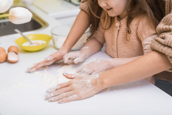 parent and child make dough on table - why benefits of sensory play
