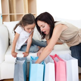 Child is excited to see Mom comes home with big shopping bag - classical conditioning