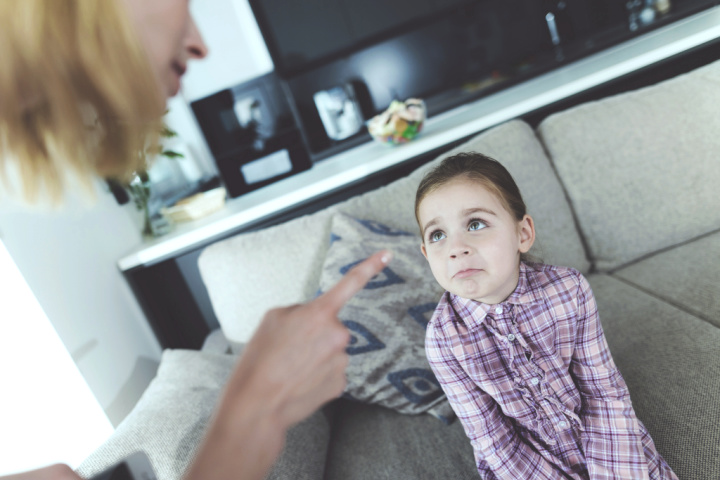 signs of an overbearing Mother: controlling mother effect on daughter points finger at girl controlling parenting