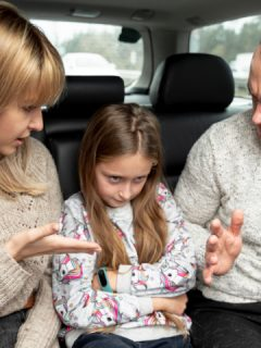 mom and dad angrily talks to girl in car backseat are controlling parents