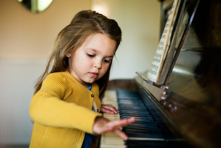 Girl plays piano - critical period for language acquisition