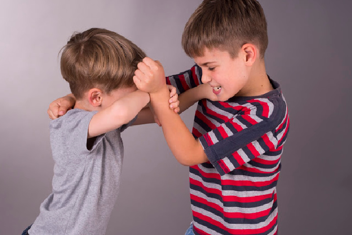 Two boys fighting - Discipline and punishment