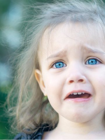 girl cries and looks scared - characteristics of disorganized attachment