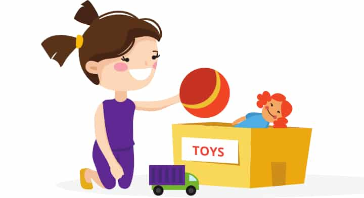 Girl picks up toy ball and puts it away into the toy box. She is doing it with a smile, examples of negative reinforcement. Sometimes a child is given food as a reward.