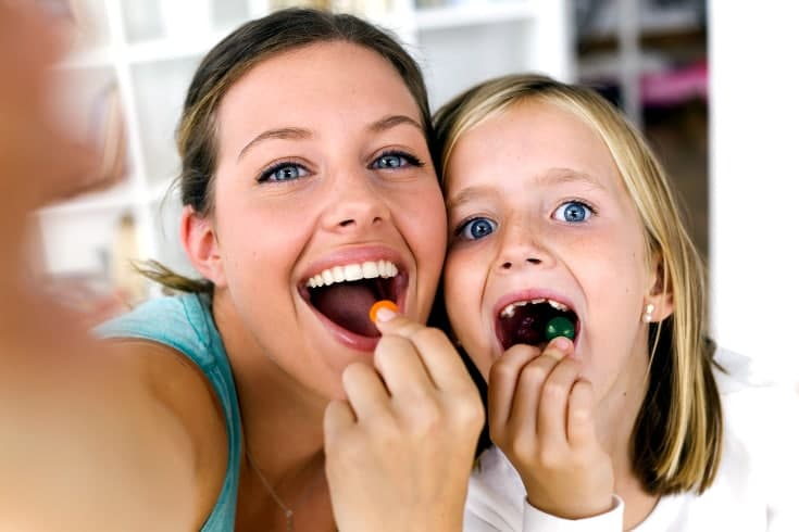 Mother daughter eat candies together - Forms of discipline