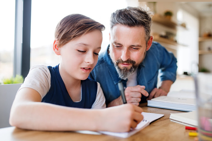 dad hovers son's writing helicopter parenting is different from lawnmower parenting