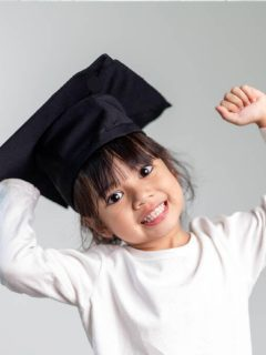 toddler girl wearing a graduation hat