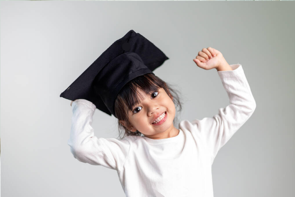 toddler girl wearing a graduation hat symbol of how to raise successful kids