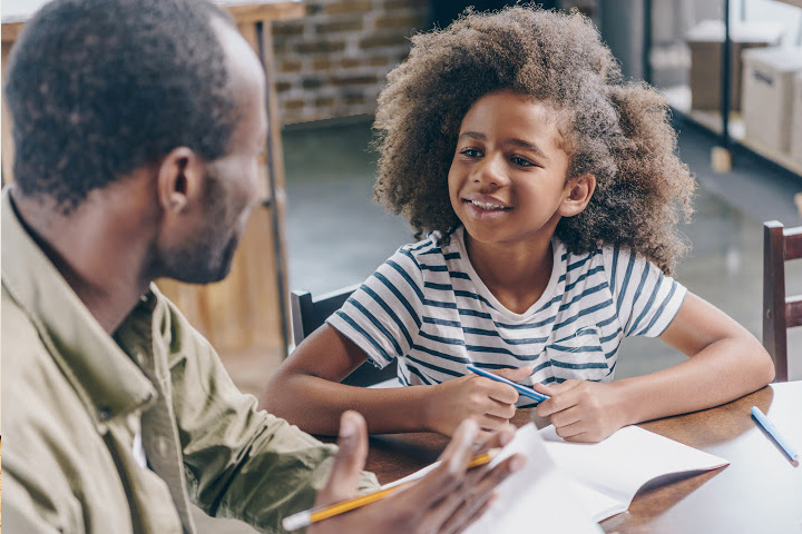 dad talks to daughter providing inductive guidance child development