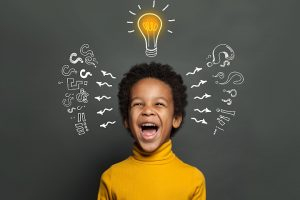 laughing kid with hand-drawn lightbulb above head