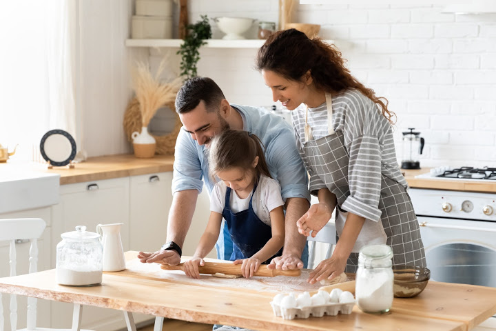 parents hover girl kneading to ensure she doesn't make mistakes exemplify helicopter parenting meaning