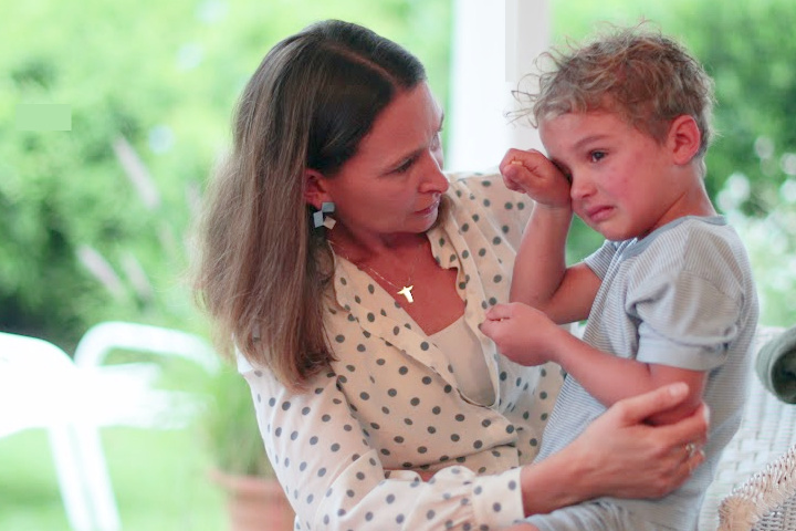 mom attends to crying boy