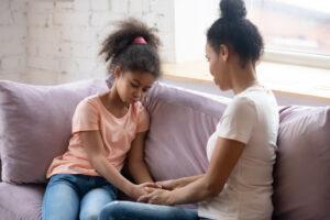 mother talks to sad daughter