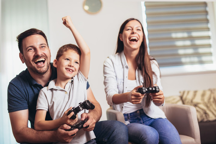 family play video game together to motivate child
