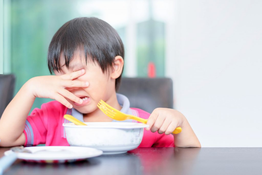 boy cries over a bowl of food under overprotective parenting