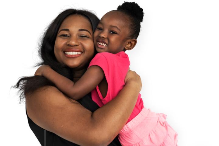 mother hugs daughter to show parental love