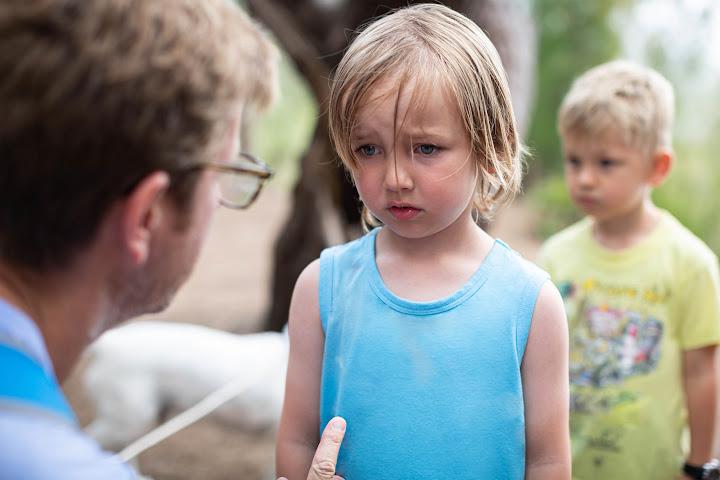 parent talks to discipline child