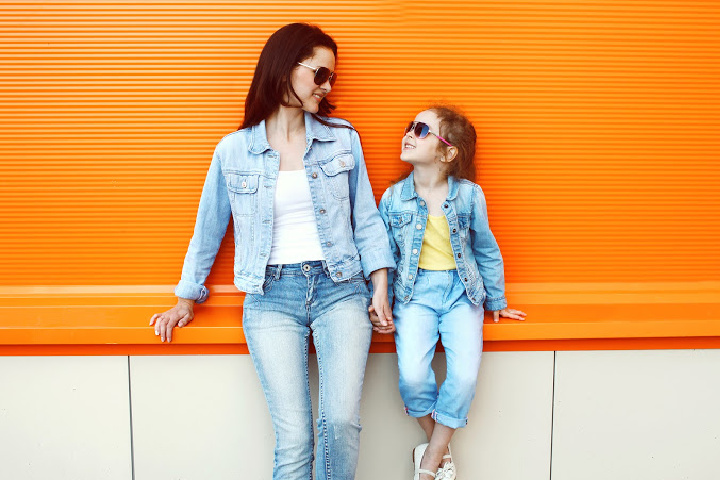 Mother and daughter both wear sunglasses. Mother models how to be a good parent by Improving parenting skills
