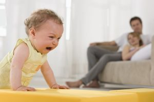 parents watch toddler cry
