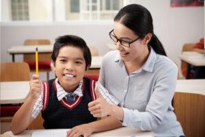 boy receive praise as reinforcement for finishing homework