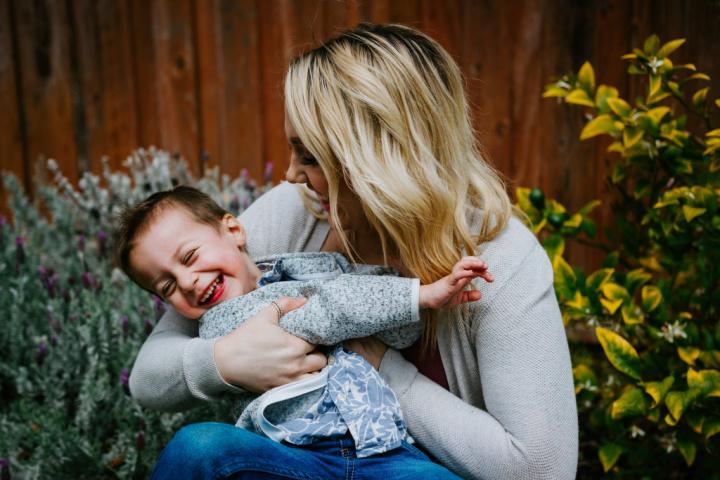 Mom and son hug and laugh together