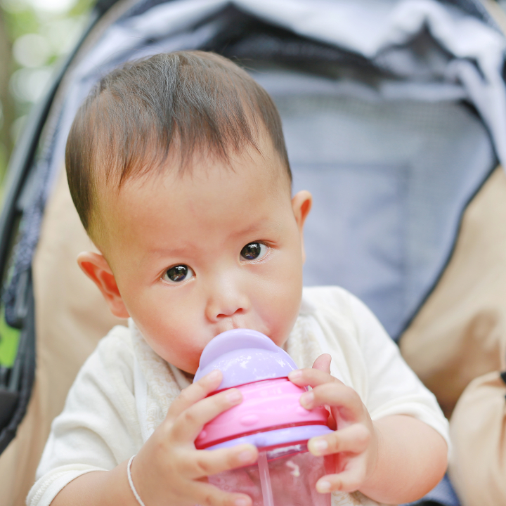 Toddler boy drinks from sippy cup - sippy cups bad for teeth