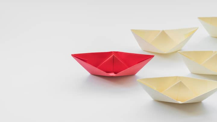 Red and white origami boats - spatial skills