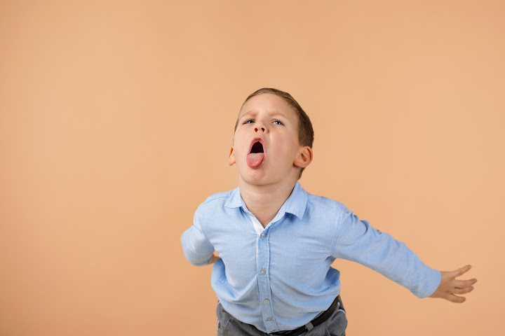 five year old boy sticks his tongue out is kids talking back
