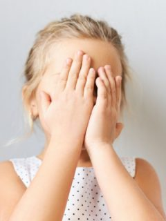 girl covers face with hands we teach kids how to handle stress